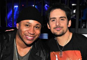 LL Cool J and Brad Paisley | Photo Credits: Jerod Harris/ACMA2013/Getty Images