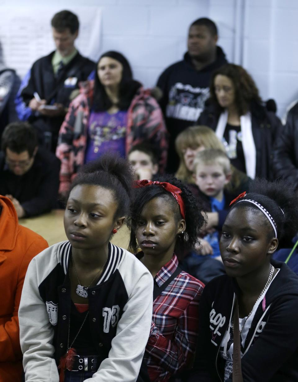 Members of the community listen during a prayer service Monday, March 11, 2013, in Warren, Ohio. Community members crowded into a prayer service to remember six teens killed when an SUV flipped over a guardrail and landed upside down in a pond. (AP Photo/Tony Dejak)