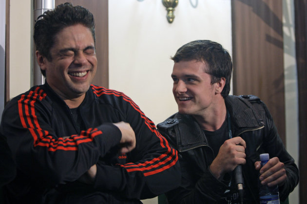 "Puerto Rico's actor Benicio del Toro, left, and US actor Josh Hutcherson laugh during the presentation of Del Toro's first film as director: ""Seven Days"" at the National hotel in Havana, Cuba, Friday, Dec. 9, 2011. (AP Photo/Franklin Reyes)"