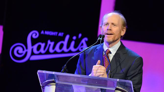 IMAGE DISTRIBUTED FOR ALZHEIMER'S ASSOCIATION - Director Ron Howard presents the Abe Burrows entertainment award on stage at the 21st Annual 'A Night at Sardi's' to benefit the Alzheimer's Association at the Beverly Hilton Hotel on Wednesday, March 20, 2013 in Beverly Hills, Calif. (Photo by Jordan Strauss/Invision for Alzheimer's Association/AP Images)