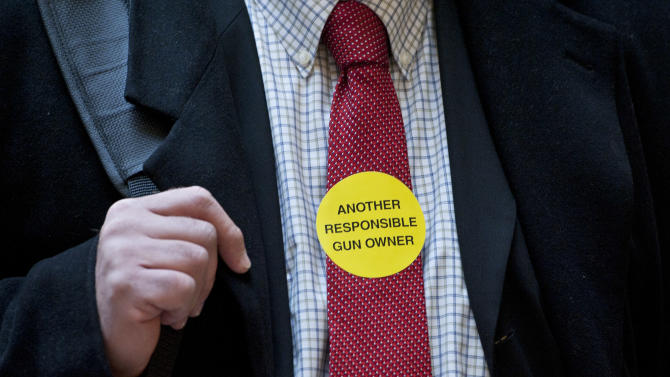 Jeff Soracco of Oxford, Conn. wears a sticker identifying him as a responsible gun owner as he waits to sign up to speak at a hearing of a legislative subcommittee reviewing gun laws at the Legislative Office Building in Hartford, Conn., Monday, Jan. 28, 2013. The parents of children killed in the Newtown school shooting called for better enforcement of gun laws Monday at the legislative hearing. (AP Photo/Jessica Hill)