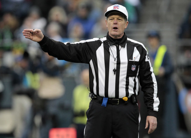 FILE - In this Nov. 13, 2011, file photo, referee Scott Green makes a call in the second half of an NFL football game between the Seattle Seahawks and Baltimore Ravens in Seattle. The NFL&#39;s on-field officials say the league planned to lock them out rather than negotiate a new contract. &quot;Lockout seems to be their negotiating strategy with everyone,&quot; said Green, president of the NFLRA, clearly referring to the lockout of the players in 2011. Members of the NFL Referees Association were locked out June 3 after talks broke down. The league has been contacting replacement officials. (AP Photo/Elaine Thompson, File)