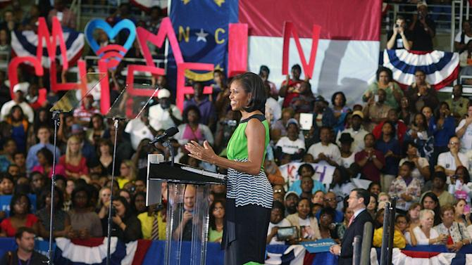 First lady Michelle Obama, speaks about the importance of voting Wednesday, Sept. 19, 2012 at Williams Arena at East Carolina University in Greenville, N.C. (AP Photo/Daily Free Press, Janet S. Carter)  MANDATORY CREDIT
