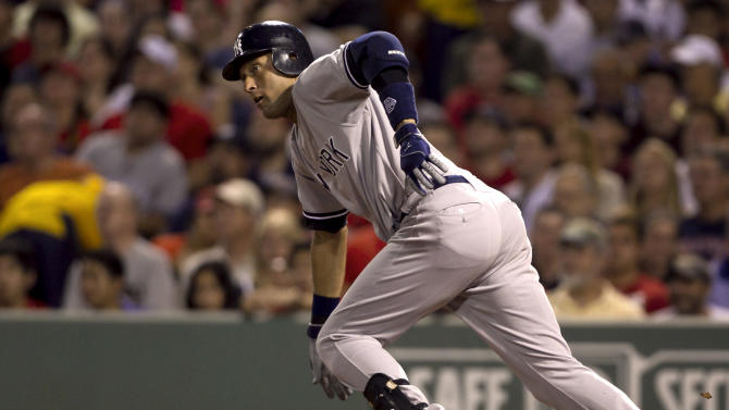 York Yankees' Derek Jeter advances to first on a single off a pitch by Boston Red Sox's Jon Lester in the second inning of a baseball game at Fenway Park in Boston, Sunday, July 8, 2012. (AP Photo/Steven Senne)