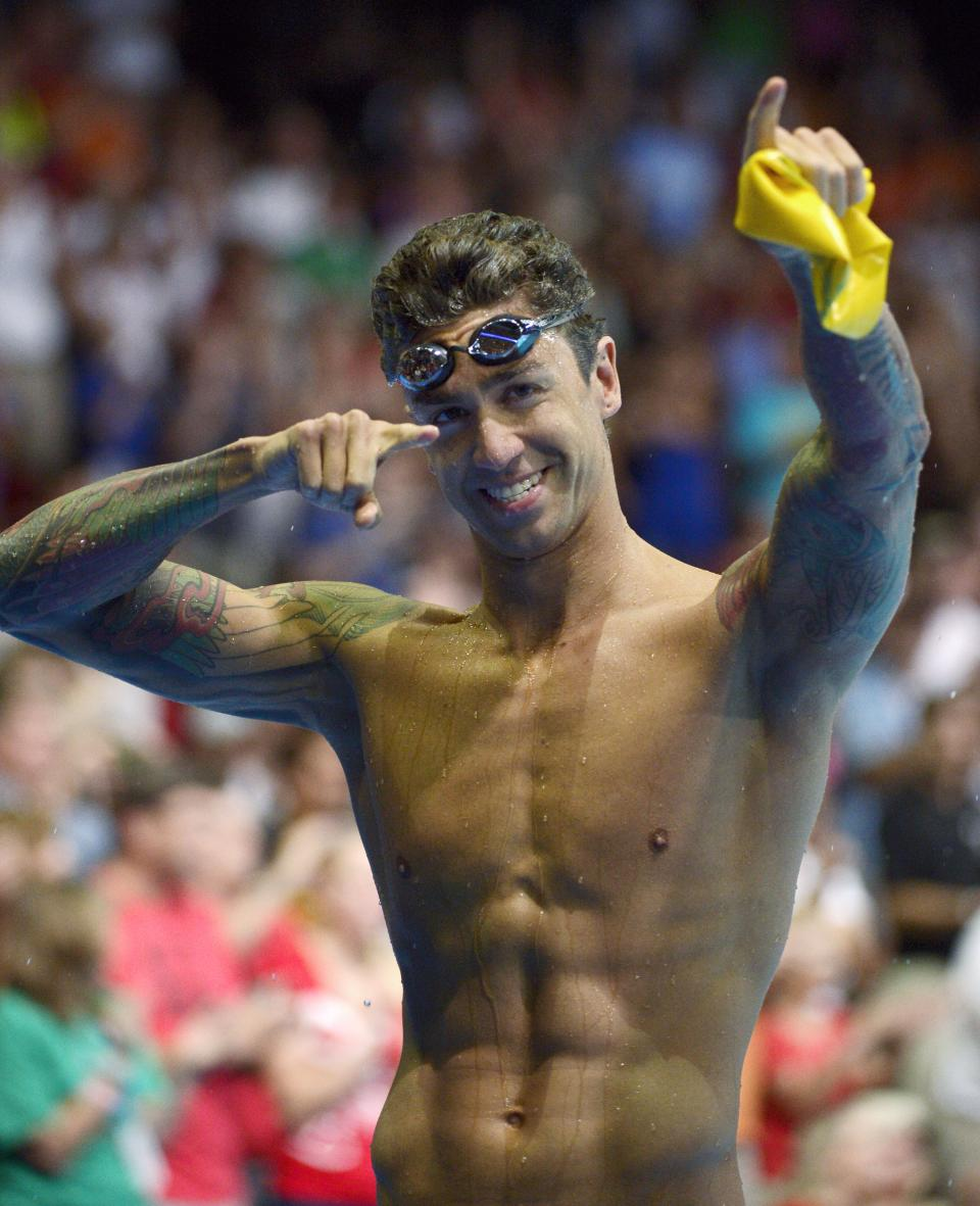 Anthony Ervin celebrates after swimming in the men's 50-meter freestyle final at the U.S. Olympic swimming trials, Sunday, July 1, 2012, in Omaha, Neb. (AP Photo/Mark J. Terrill)
