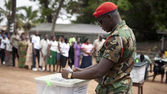 A soldier casts his votes in parliamentary and presidential elections, at an outdoor polling station in Accra, Ghana, Friday, Dec. 7, 2012. Ghanaians went to the polls Friday to choose between four candidates, including President John Dramani Mahama, who inherited the top post in July after President John Atta Mills died in office, and Nana Akufo-Addo, who lost the presidency by less than one percent to Mills in 2008. With its coup era over and five peaceful elections under its belt, Ghana is expected to hold a peaceful poll as voters decide which candidate will ensure the country's new-found wealth reaches the poor and middle-class. (AP Photo/Gabriela Barnuevo)