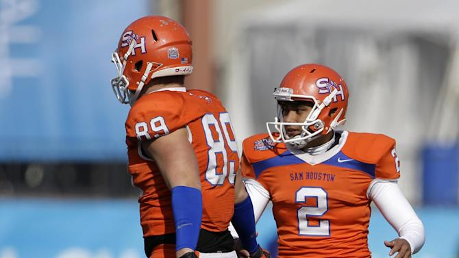 Sam Houston State's Shane Young (89) congratulates Miguel Antonio (2) on his field goal in the first half of the FCS Championship NCAA college football game against North Dakota State Saturday, Jan. 5, 2013, in Frisco, Texas. (AP Photo/Tony Gutierrez)