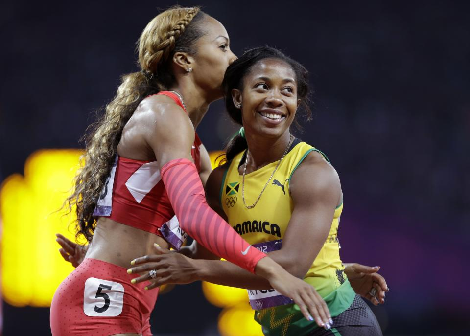 Jamaica's Shelly-Ann Fraser-Pryce embraces United States' Sanya Richards-Ross after their women's 200-meter semifinal during the athletics in the Olympic Stadium at the 2012 Summer Olympics, London, Tuesday, Aug. 7, 2012. (AP Photo/Anja Niedringhaus)