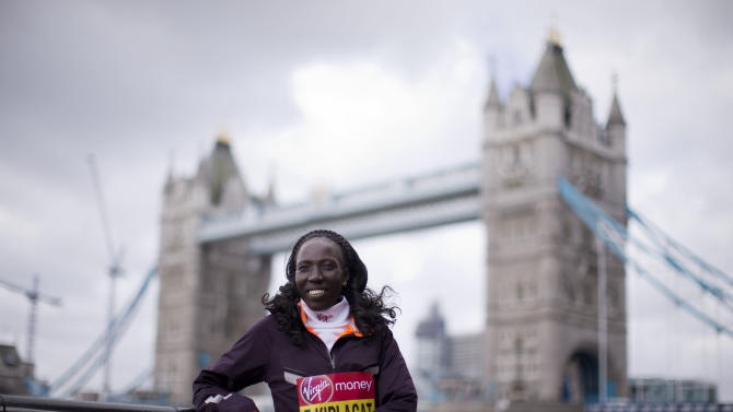 Elite women's marathon runner Kenya's Edna Kiplagat poses for photographs during a media opportunity backdropped by Tower Bridge in London, Thursday, April 18, 2013. The London Marathon will go ahead on Sunday despite security fears in the wake of the bomb blasts in the Boston race that killed at least three runners and injured many more. (AP Photo/Matt Dunham)