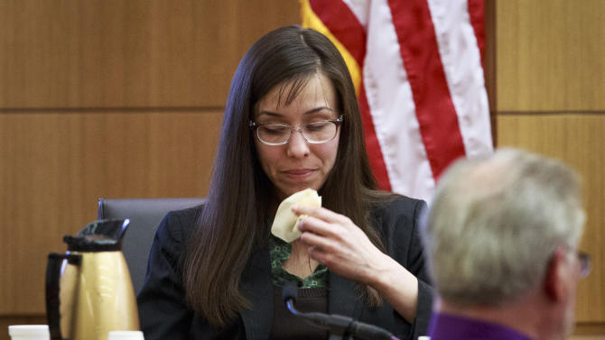 Defendant Jodi Arias talks about her relationship with Travis Alexander as she testifies in her murder trial in Judge Sherry Stephens' Superior Court, on Wednesday, Feb. 6, 2013.  Arias, 32, is accused of stabbing and slashing Alexander, 27 times, slitting his throat and shooting him in the head in his suburban Phoenix home in June 2008. She initially denied any involvement, then later blamed it on masked intruders before eventually settling on self-defense.  (AP Photo/The Arizona Republic, Charlie Leight)