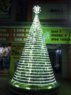 In this Dec. 9, 2011 photo released by Westcom Electronics, a Christmas pine tree made of unusable cellphones is lit up in front of the electronic store in My Tho, Tien Giang province, Vietnam. The store is ringing in Christmas with the 15-foot tree made of more than 2,500 unusable cellphones. Store manager Nguyen Trai said 10 workers spent two weeks building the cellular Christmas tree. (AP Photo/Westcom Electronics)