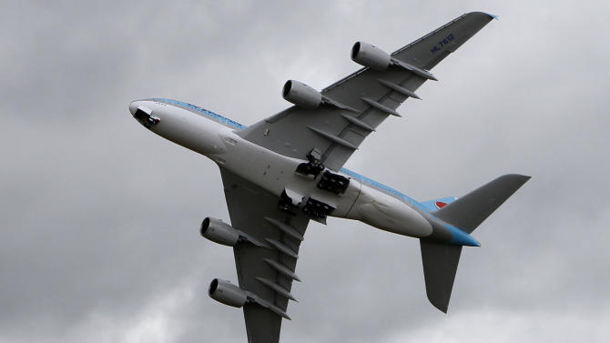 A Korean Air Lines Airbus A380 performs its demonstration flight, on the first day of the Paris air show at le Bourget airport, east of Paris, Monday June 20, 2011. (AP Photo/Francois Mori)