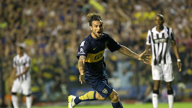 Daniel Osvaldo of Argentina's Boca Juniors celebrates after scoring against Uruguay`s Wanderers during a Copa Libertadores soccer match in Buenos Aires, Argentina, Thursday, Feb. 26, 2015. (AP Photo/Rodrigo Abd)