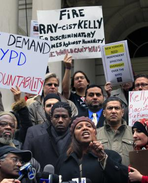 "City Council Member Letitia ""Tish"" James, center, is surrounded by members of the Muslim American Civil Liberties Coalition (MACLC) and supporters on the steps of City Hall, as she speaks at a press conference calling for further investigation of a NYPD anti-Muslim training video, Thursday, Jan. 26, 2012 in New York.  Police Commissioner Raymond Kelly and his public affairs commissioner Paul Browne being criticized for the production of the movie used in the training of 1,500 police cadets. (AP Photo/Bebeto Matthews)"