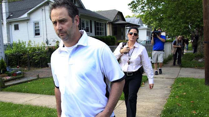 Investigators leave a residence in Maple Shade, N.J., Thursday, May 24, 2012. A woman who answered the door said that it is the home of Pedro Hernandez, who is in custody in the disappearance of Etan Patz in 1979. Hernandez has implicated himself in the death of Patz, police said Thursday. (AP Photo/Mel Evans)