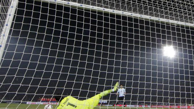 Chile's goalie Claudio Bravo makes a save on a penalty kick by Argentina's Ever Banega during their Copa America 2015 final soccer match at the National Stadium in Santiago
