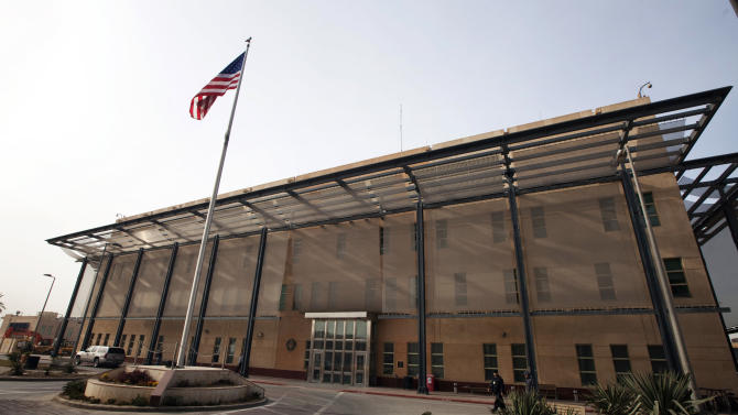 A U.S. flag flies in front of the Chancellery building inside the compound of the U.S. embassy in Baghdad