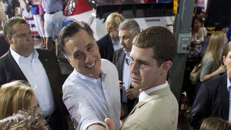 Republican presidential candidate Mitt Romney, center, greets supporters at a rally Sunday, Aug. 12, 2012, in Mooresville, N.C., at the NASCAR Technical Institute. (AP Photo/Jason E. Miczek)