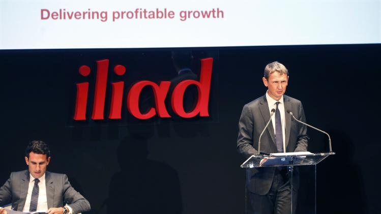 Maxime Lombardini, Chief Executive Officer of French broadband Internet provider Iliad, and Thomas Reynaud, Iliad chief financial officer, attend the company's 2014 first half results presentation in Paris