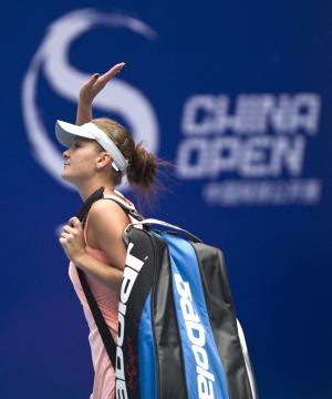 Poland's Agnieszka Radwanska waves to spectators while leaving the court after the women's singles quarterfinal match against Ana Ivonovic of Serbia at the China Open tennis tournament in Beijing Friday, Oct 7, 2011. Agnieszka won the match 6-3, 3-2 after Ivonovic withdrew due to her injury. (AP Photo/Andy Wong)