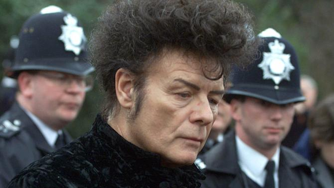 FILE - In this Jan, 11, 2000 file photo, British performer Gary Glitter, during a press conference in London. Police investigating the sex abuse scandal surrounding late BBC children's television host Jimmy Savile have arrested pop star Gary Glitter in connection with the case, British media said Sunday, Oct. 28, 2012. Metropolitan Police said they arrested a man in his 60s early Sunday morning at his London home, on suspicion of sexual offenses, and that he remains in custody in a London police station. (AP Photo/Alastair Grant, File)