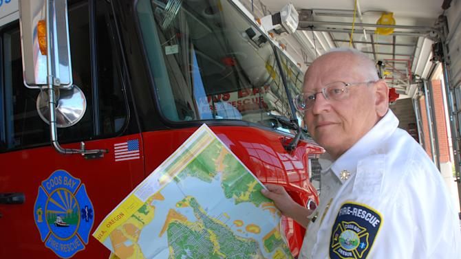 Fire Chief Stan Gibson shows off the tsunami inundation map Thursday, May 31, 2012 at the fire station in Coos Bay, Ore., where authorities expected thousands of people to take part in a tsunami evacuation drill. Authorities say the tsunami in Japan last year has heightened awareness of local dangers. (AP Photo/Jeff Barnard)