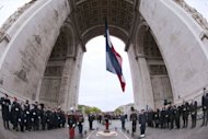French soldiers parade during a ceremony marking the 67th anniversary of the Allied victory over Nazi Germany in World War II, in Paris. Pressure built on president-elect Francois Hollande to stand by France&#39;s austerity vows Tuesday, with Germany&#39;s Angela Merkel saying Europe was counting on them to resolve the bloc&#39;s debt crisis