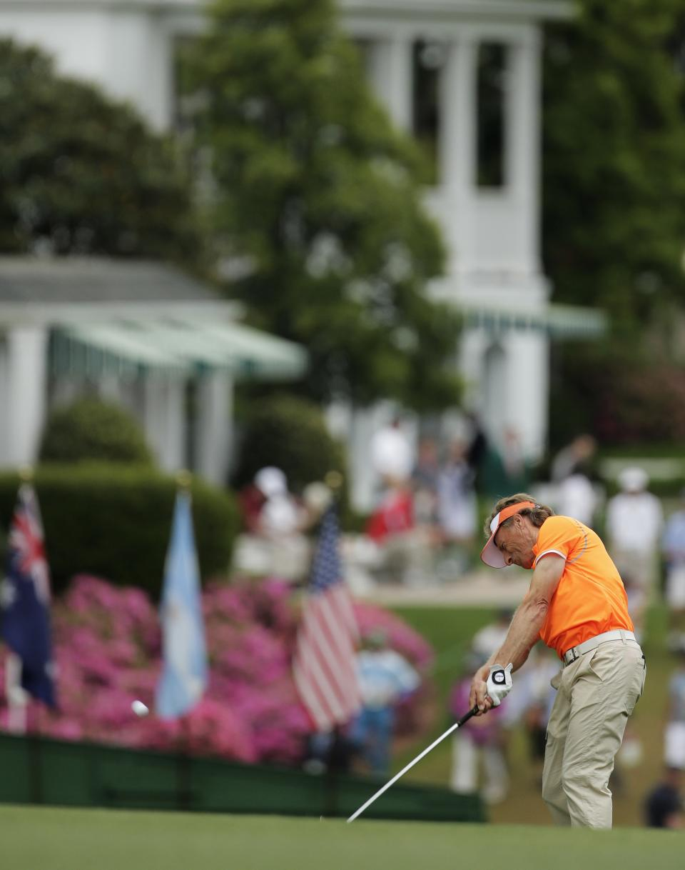 Bernhard Langer, of Germany, hits his second shot off the first fairway during the fourth round of the Masters golf tournament Sunday, April 14, 2013, in Augusta, Ga. (AP Photo/Charlie Riedel)