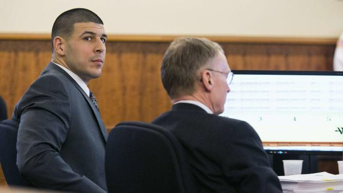 Former NFL player Aaron Hernandez looks at the prosecutor during his murder trial at the Bristol County Superior Court in Fall River