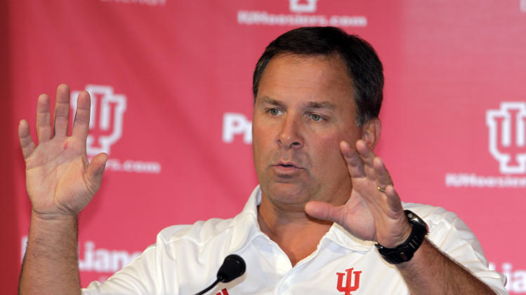 FILE - This Aug. 9, 2011 file photo shows Indiana NCAA college football head coach Kevin Wilson responds to a question during media day in Bloomington, Ind. Wilson wants to change the culture of Indiana football. First, he has to change the mindset. (AP Photo/Darron Cummings, File)
