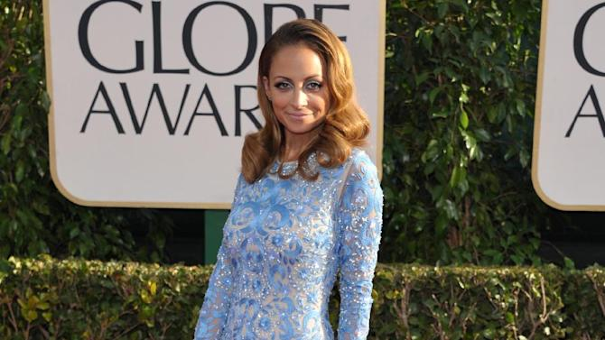 Nicole Richie arrives at the 70th Annual Golden Globe Awards at the Beverly Hilton Hotel on Sunday Jan. 13, 2013, in Beverly Hills, Calif. (Photo by John Shearer/Invision/AP)