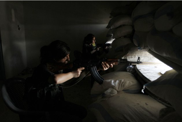 Kurdish female fighters take positions to guard the area in Aleppo's Sheikh Maqsoud neighborhood