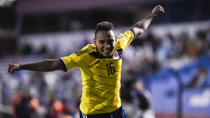 Colombia's Jarian Barrera celebrates his goal against Argentina during the South America Under-20 soccer match in Montevideo, Uruguay, Thursday, Jan. 29, 2015. (AP Photo/Matilde Campodonico)
