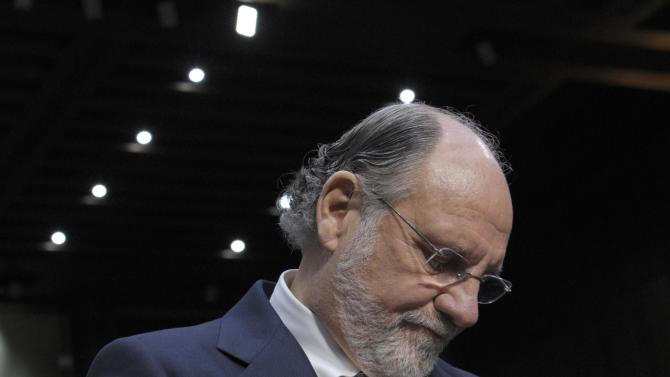"""In this Tuesday, Dec. 13, 2011, file photo, former MF Global Holdings Ltd. Chairman and CEO Jon Corzine arrives on Capitol Hill in Washington, to testify before the Senate Agriculture Committee hearing to examine MF Global bankruptcy. The trustee in the MF Global Holdings bankruptcy case sued ex-CEO Jon Corzine on Tuesday, April 23, 2013, and two other former executives, alleging that they """"failed to act in good faith"""" while running the company.(AP Photo/Susan Walsh)"""