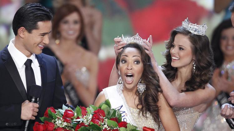 FILE - In this Jan. 30, 2010 file photo, host Mario Lopez watches Miss Virginia Caressa Cameron react after being crowned Miss America 2010 by Miss America 2009 Katie Stam in Las Vegas. (AP Photo/Eric Jamison)