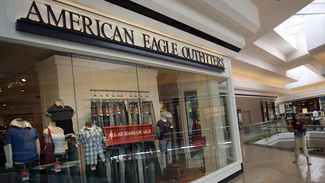 FILE - In this Monday, Aug. 14, 2006 file photo, a shopper heads into the American Eagle store in Cherry Creek Mall in east Denver. On Wednesday, Aug. 21, 2013, American Eagle reported that their second-quarter net income climbed 3 percent to meet analysts' expectations, but revenue fell as the retailer contended with declining traffic and tough competition. The company also issued a third-quarter profit outlook well below Wall Street's view. (AP Photo/David Zalubowski, File)