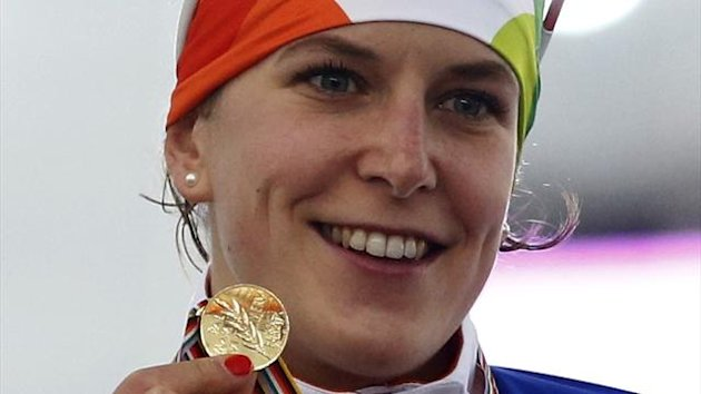 Winner Ireen Wust of Netherlands shows her gold medal on the podium after the women's 1500m event at the Essent ISU World Single Distances Championships (Reuters)