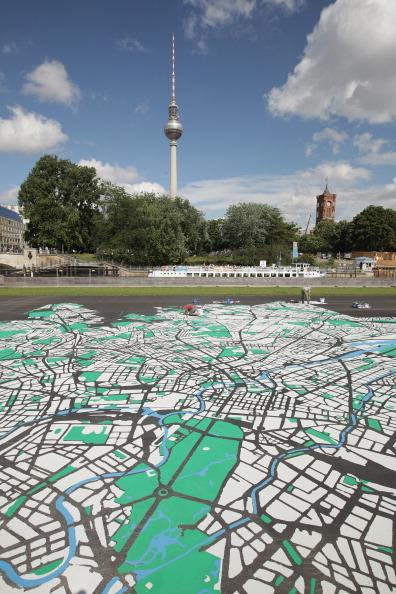 ast tower at Alexanderplatz and City Hall (R) on August 6, 2012 in Berlin, Germany. The map, which will measure 50 meters X 50 meters when finished, is in the scale of 1:775 and is an art installation meant to coincide with 775th anniversary of Berlin, which the city will celebrate in October. (Photo by Sean Gallup/Getty Images)
