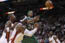 Boston Celtics forward Pierce drives to the basket as Miami Heat defenders Bosh, James and Wade pursue in the second half during their NBA basketball game in Miami