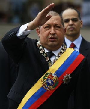 Venezuela's President Hugo Chavez salutes upon his arrival to the national pantheon to attend a ceremony marking the 181th anniversary of the death of Venezuela's independence hero Simon Bolivar in Caracas,Venezuela, Saturday, Dec. 17, 2011. (AP Photo/Fernando Llano)
