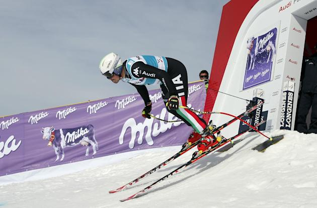 Italy's Peter Fill competes on his way to clock the fifth fastest time during an alpine ski, men's World Cup downhill training, in Lanzerheide, Switzerland, Tuesday, March 11, 2014