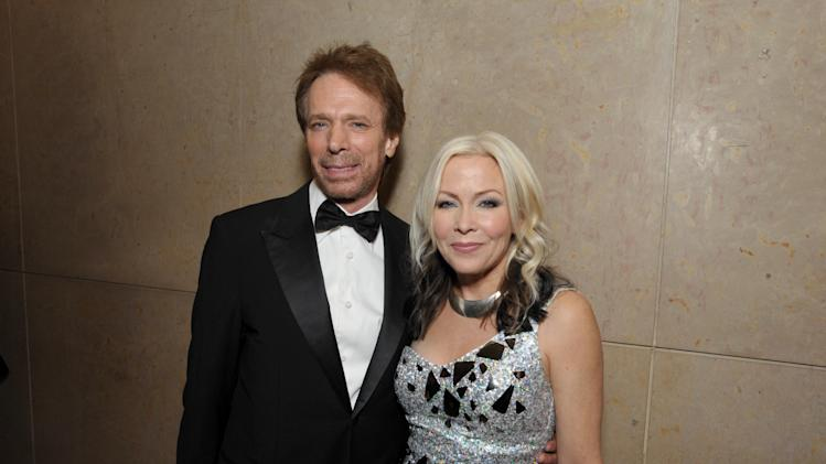 Jerry Bruckheimer, left, and Terri Nunn attend the presentation of the 27th Annual American Cinematheque Award to Jerry Bruckheimer on Thursday, Dec. 12, 2013, in Beverly Hills, Calif. (Photo by John Shearer/Invision for American Cinematheque/AP Images)
