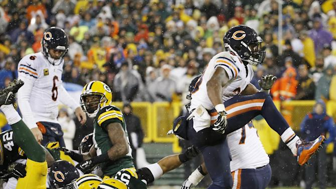 Chicago Bears' Jeremy Langford celebrates his touchdown run during the first half of an NFL football game against the Green Bay Packers Thursday, Nov. 26, 2015, in Green Bay, Wis. (AP Photo/Morry Gash)