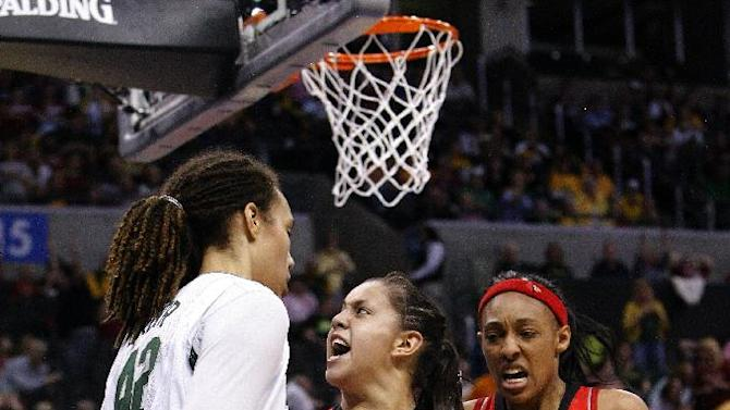 Louisville's guard Shoni Schimmel, center, reacts to her shot over Baylor's Brittney Griner, left, as Louisville's Sheronne Vails, right, stands by during the second half of a regional semifinal in the women's NCAA college basketball tournament in Oklahoma City, Sunday, March 31, 2013. Louisville won 82-81. (AP Photo/Alonzo Adams)
