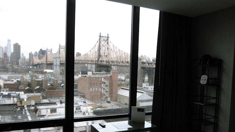 This March 6, 2013 photo shows the view from inside a room at the Z, a boutique hotel in Long Island City, in the Queens borough of New York. The Z is one of 20 hotels in the neighborhood that are luring tourists to the Queens side of the East River with moderate prices. Every room has a view of Manhattan's skyline and the Ed Koch Queensborough Bridge, also known as the 59th Street Bridge. Tourists will also find museums, waterfront parks and good restaurants in the area, along with easy access to Manhattan. (AP Photo/Beth J. Harpaz)