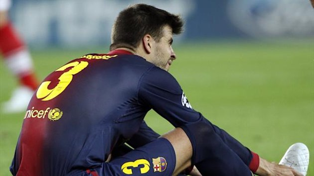 Barcelona&#39;s Gerard Pique grimaces after picking up an injury during the Champions League Group G match against Spartak Moscow at Nou Camp (Reuters)