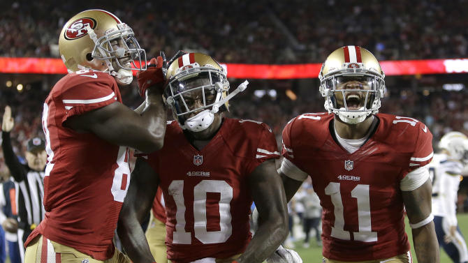 San Francisco 49ers wide receiver Bruce Ellington (10) celebrates after scoring on 1-yard touchdown run, with wide receivers Anquan Boldin (81) and Quinton Patton (11) during the second quarter of an NFL football game against the San Diego Chargers in Santa Clara, Calif., Saturday, Dec. 20, 2014. (AP Photo/Marcio Jose Sanchez)