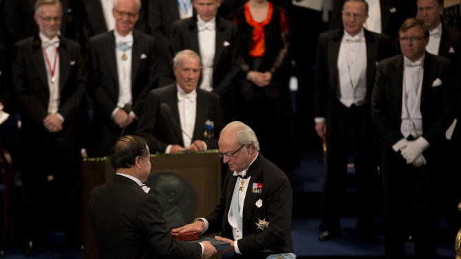 The 2012 Nobel Prize Laureate for Literature China's Mo Yan receives his Nobel Prize from Sweden's King Carl XVI Gustaf, right, during the Nobel Prize award ceremony at the Stockholm Concert Hall in Stockholm, Monday, Dec. 10, 2012. The Nobel awards are always awarded on Dec. 10, the anniversary of Alfred Nobel's death in 1896. The prizes for laureates in medicine, chemistry, physics and literature are awarded in the Swedish capital Stockholm, whilst the Nobel Peace Prize is awarded on the same day in Oslo, Norway. (AP Photo/Matt Dunham)