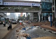 Hydro pumps remove water after flooding inside a building's parking lot in downtown Jakarta, on January 19, 2013, after three bodies were pulled out of the floodwaters. The death toll from floods in Indonesia's capital has so far risen to 15