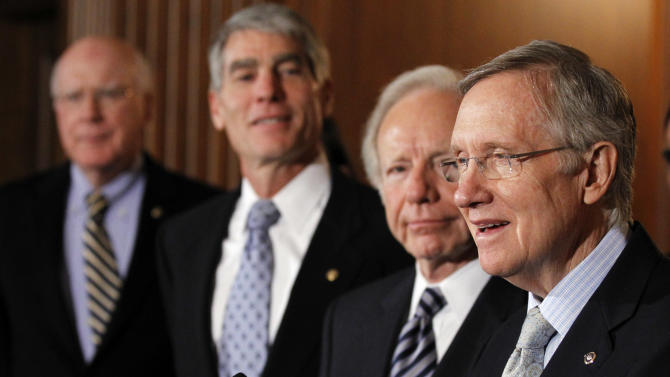 """Senate Majority Leader Sen. Harry Reid, D-Nev., from right, speaks as he stands with Sen. Joesph Lieberman, I-Conn., Sen. Mark Udall, D-Colo., and Sen. Patrick Leahy, D-Vt., at a news conference about the """"Don't Ask Don't Tell"""" bill during an unusual Saturday session on Capitol Hill in Washington Saturday, Dec. 18, 2010.(AP Photo/Alex Brandon)"""